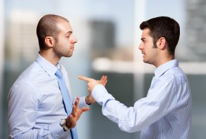 Businessman scolding a colleague